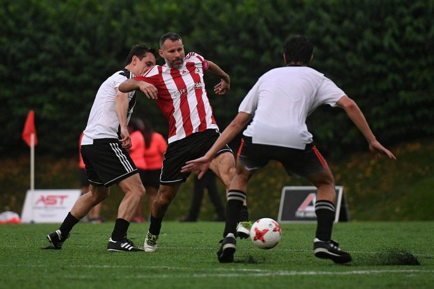 Manchester United legends Ryan Giggs (centre) and Gary Neville (left) in action while playing in the inaugural CF Cup Final, after the opening ceremony of The Arena and Cafe Football at Woodleigh Park on April 8, 2017.