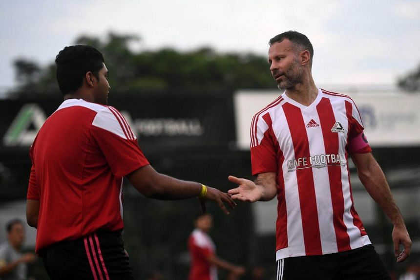 Manchester United legend Ryan Giggs congratulates a teammate while playing in the inaugural CF Cup Final, after the opening ceremony of The Arena and Cafe Football at Woodleigh Park on April 8, 2017.
