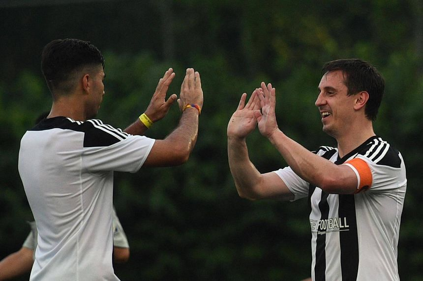 Manchester United legend Gary Neville high-fives a teammate while playing in the inaugural CF Cup Final, after the opening ceremony of The Arena and Cafe Football at Woodleigh Park on April 8, 2017.