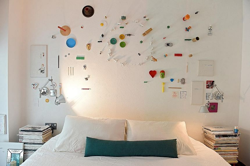 A wall in the master bedroom (above) features about 60 items, each holding a memory of six-year-old Trevi, daughter of Mr Dennis Cheok and his wife, Maggie.