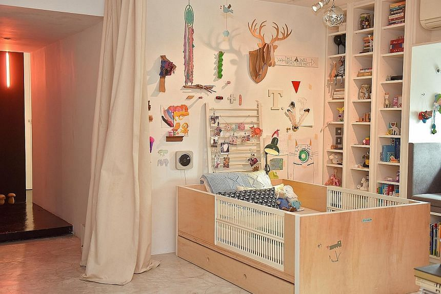 The child's bed (above) is built by Mr Cheok using plywood and fitted with slats from her baby crib.