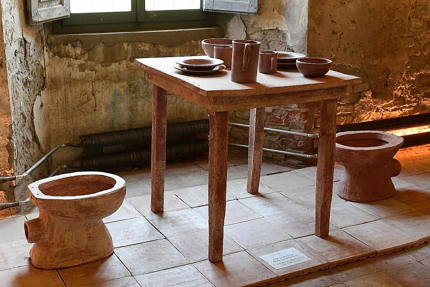 """Furniture and tableware made from a material called Merdacotta (meaning """"baked dung"""" in Italian) on show at the Shit Museum in Gragnano Trebbiense, Italy. The idea originated from a farm with cows producing milk and loads of dung daily to be recycled"""