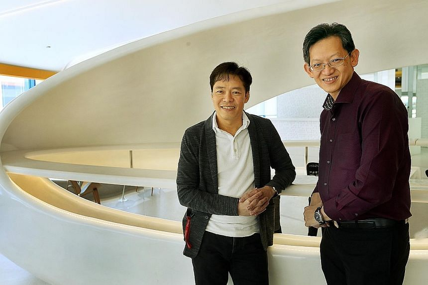 DeClout's chief executive Vesmond Wong (far left) and vCargo Cloud's chief executive Desmond Tay. DeClout started investing in vCargo Cloud in 2015, and now holds a 50.01 per cent stake.