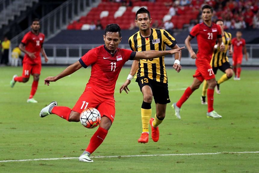 Singapore striker Sahil Suhaimi (No. 11) shaping up to shoot after coming on as a substitute during the match between Singapore and Malaysia at the Causeway Challenge at National Stadium on Oct 7, 2016.