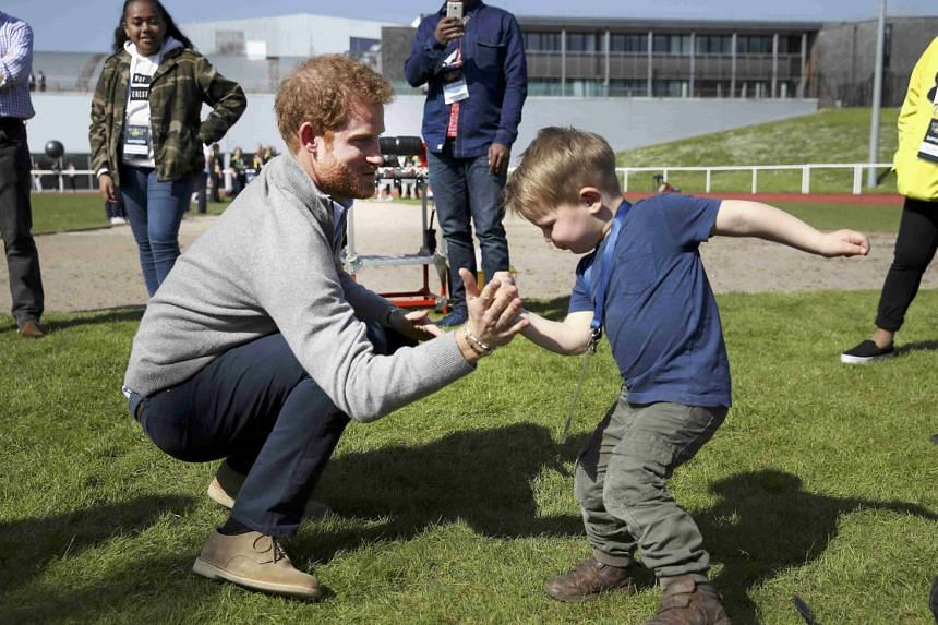 Britain's Prince Harry Patron playing with Harry Phillips as he attends the UK team trials for the Invictus Games Toronto 2017, held at the University of Bath, Britain, on April 7, 2017.