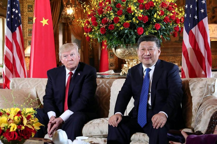 US President Donald Trump welcomes Chinese President Xi Jinping at Mar-a-Lago state in Palm Beach, Florida, US, on April 6, 2017.