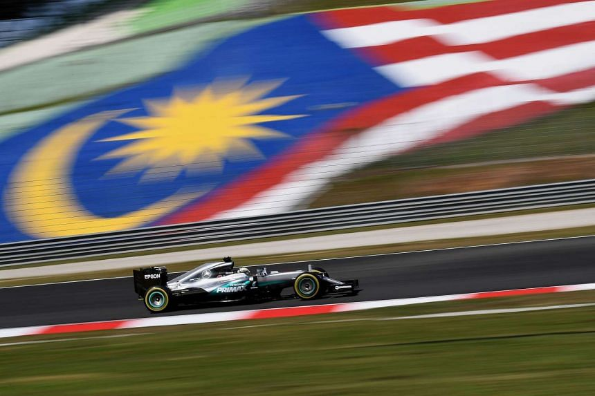 Mercedes AMG Petronas F1 Team's British driver Lewis Hamilton driving his car during the first free practice session of the 2016 Formula One Malaysia Grand Prix in Sepang on Sept 30, 2016.