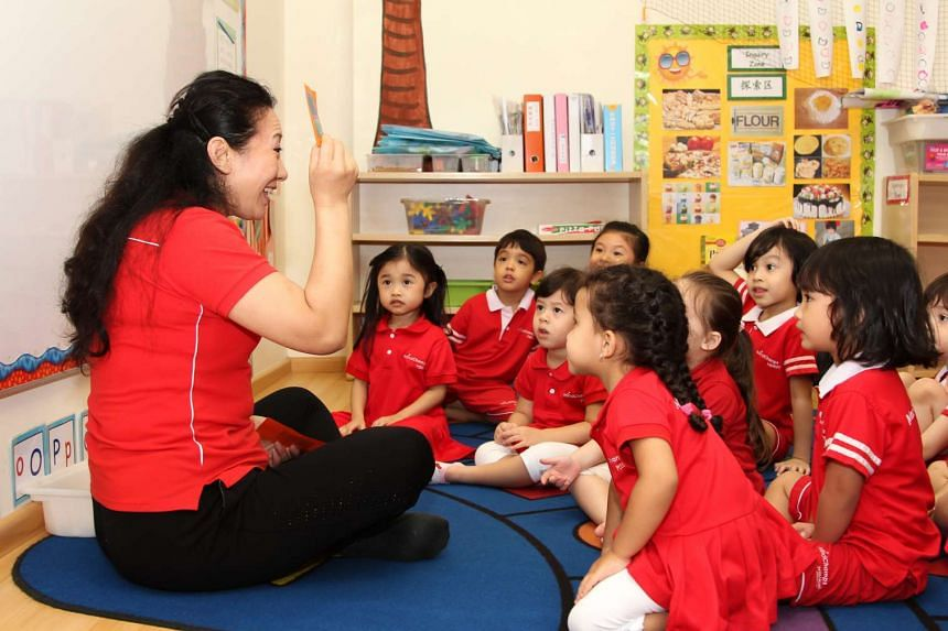 A teacher carrying out an activity with pre-schoolers at MindChamps PreSchool.