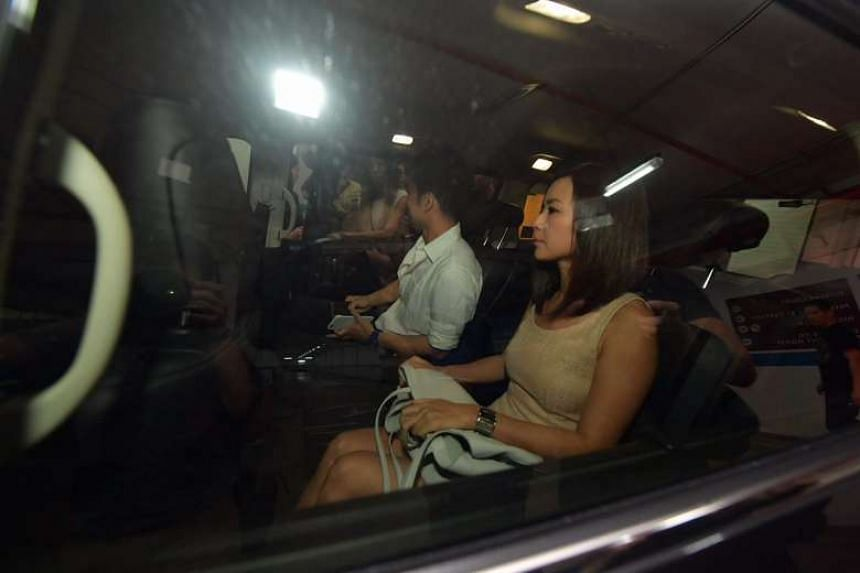 Former City Harvest Church finance manager Serina Wee and her husband Kenny Low leaving the court.