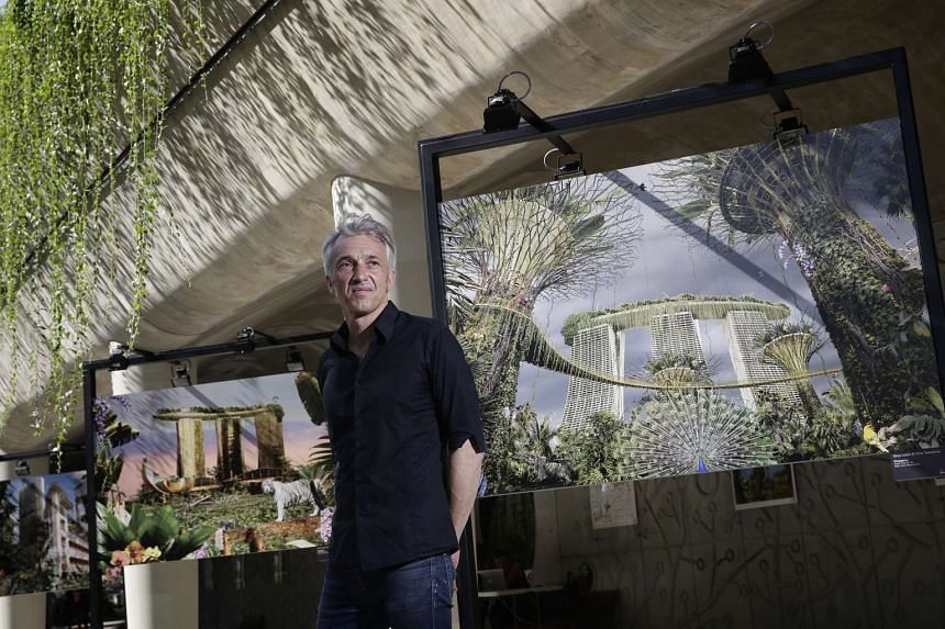 Photographer Chris Morin-Eitner with his works featuring Gardens by the Bay (forefront) and the Marina Bay Sands (background).