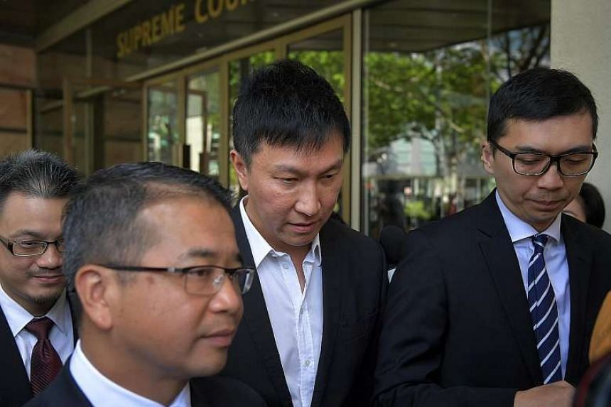 "Kong Hee leaving the court. In meting out the harshest sentence among the six church leaders to Kong, the judges agreed he was the ""ultimate leader"" of the five others."