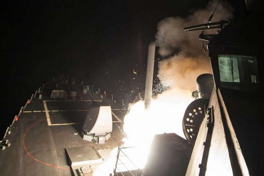 US Navy guided-missile destroyer USS Ross (DDG 71) fires a tomahawk land attack missile from the Mediterranean Sea.