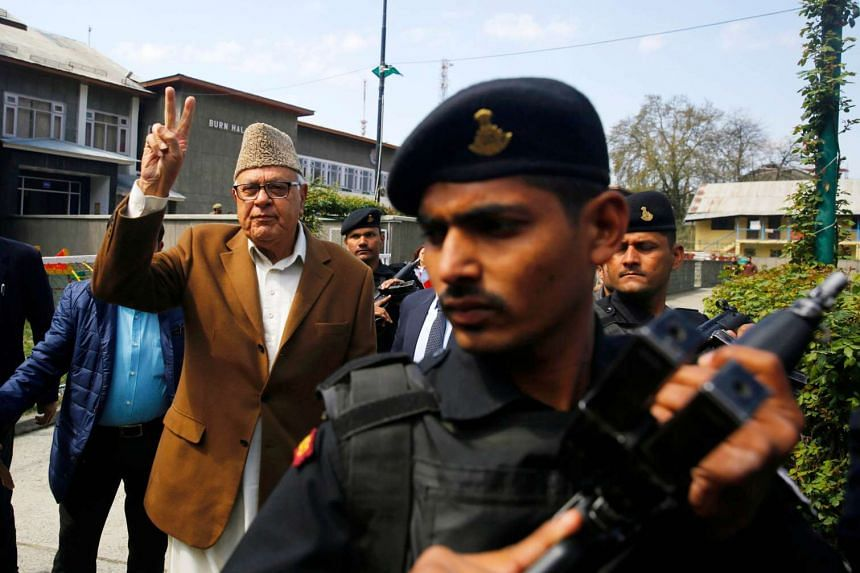 Candidate Farooq Abdullah arrives at a polling station amid high security.