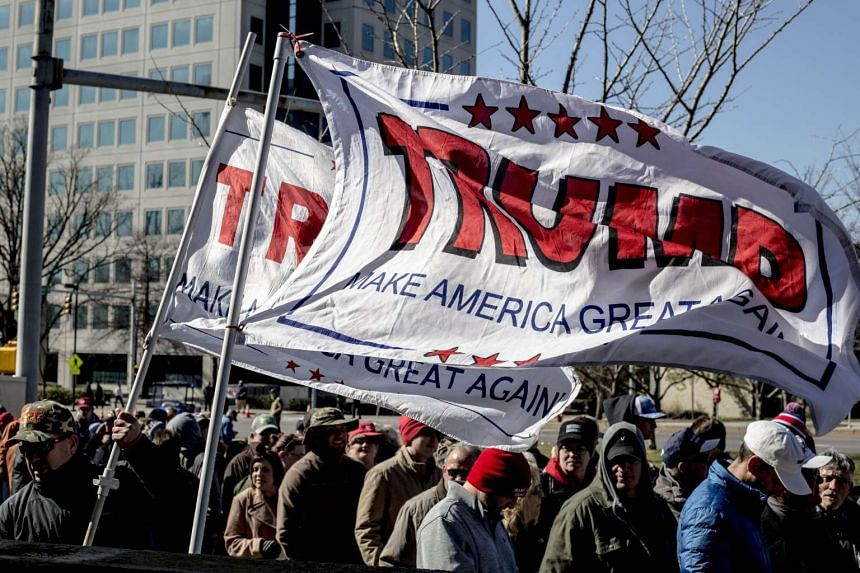 People hoping to attend a rally held by President Donald Trump line up along James Robertson Parkway on March 15, 2017 in Nashville, Tennessee.