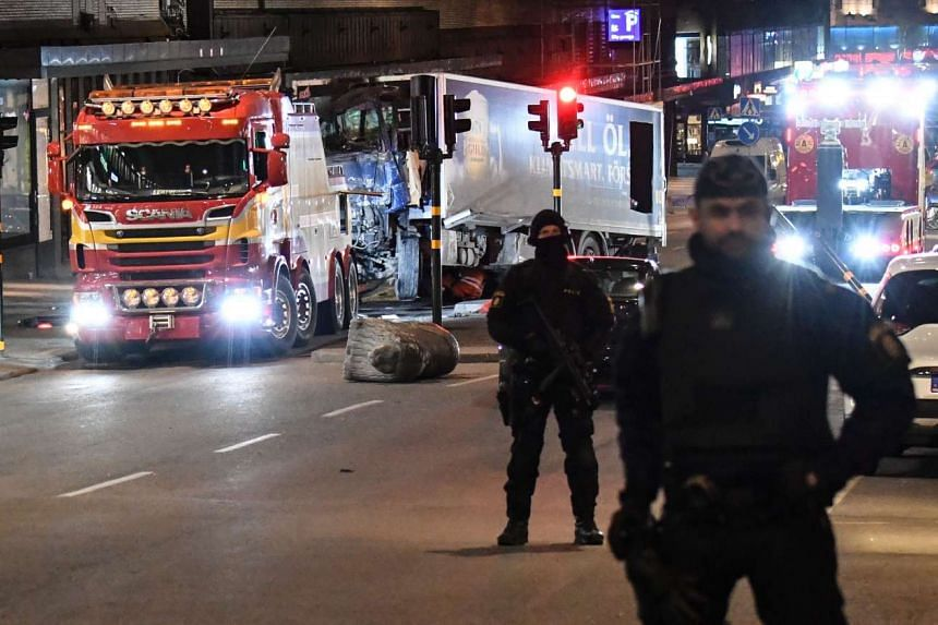 This picture taken on April 8, 2017, shows the truck (bottom left) that crashed into the Ahlens department store at Drottninggatan in central Stockholm.