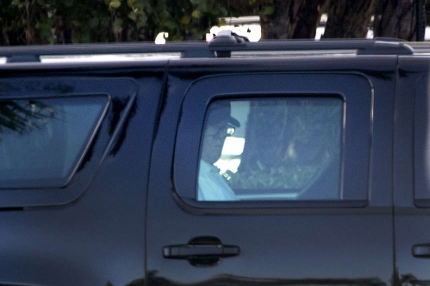 Donald Trump in his SUV as he heads to the Trump International Golf Club in West Palm Beach, Florida, April 8, 2017.