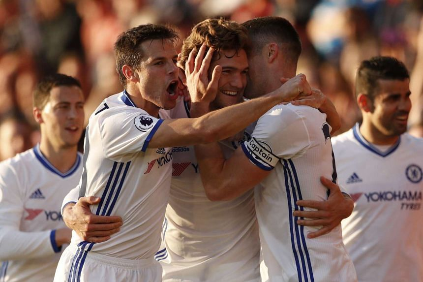 Chelsea's Marcos Alonso celebrates scoring their third goal with teammates.