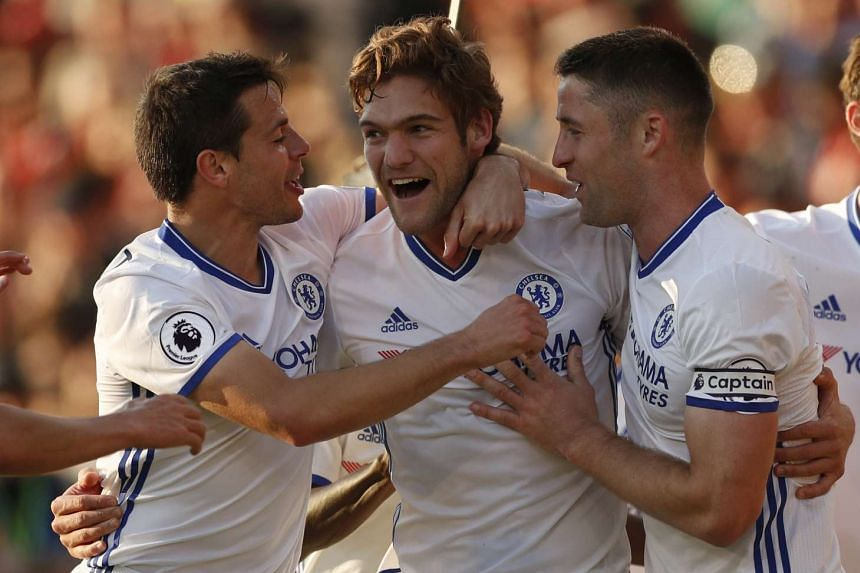 Chelsea's Marcos Alonso celebrates scoring their third goal with Cesar Azpilicueta and Gary Cahill.