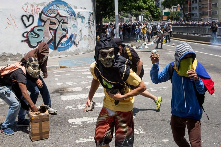 Demonstrators clash with police during a protest in Caracas, Venezuela on April 8, 2017.