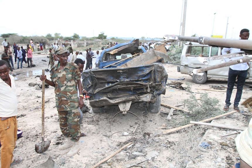 Military personnel at the site of a car bombing outside a military base in Mogadishu, Somalia, on April 9, 2017.