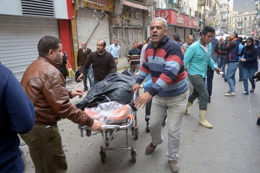 A victim of the bombing is taken away on a stretcher.