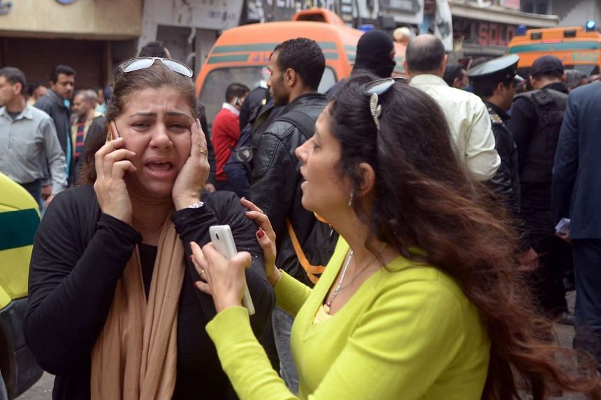 Distraught relatives of victims of the bombing outside the church in Alexandria.