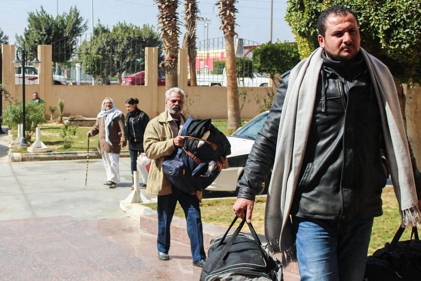 Egyptian Coptic Christians arrive with their belongings to take refuge at the Evangelical Church in the Suez Canal city of Ismailiya on Feb 25, 2017.