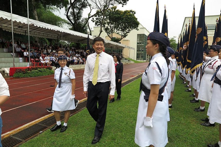 Minister for Education (Schools) Ng Chee Meng inspecting the GBS officers' contingent during their 90th anniversary parade yesterday.