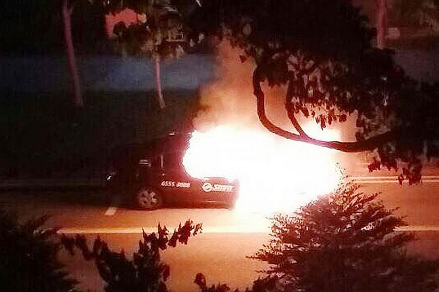 The taxi driver and his passenger got out of the taxi when it started emitting smoke, before it burst into flames last Friday.