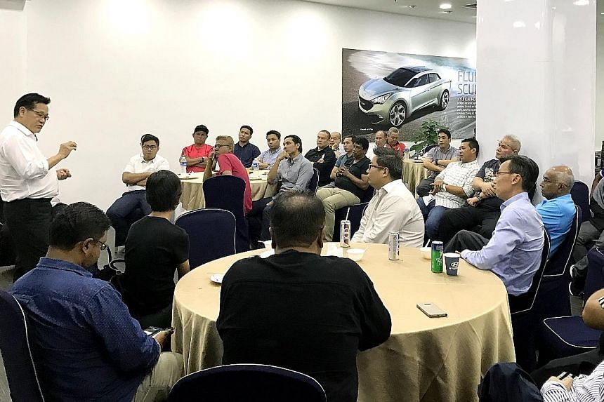 """FAS presidential candidate Lim Kia Tong addressing officials from NFL clubs last month. Affiliates want an end to the """"top-down"""" approach so that talent can be spotted and developed."""
