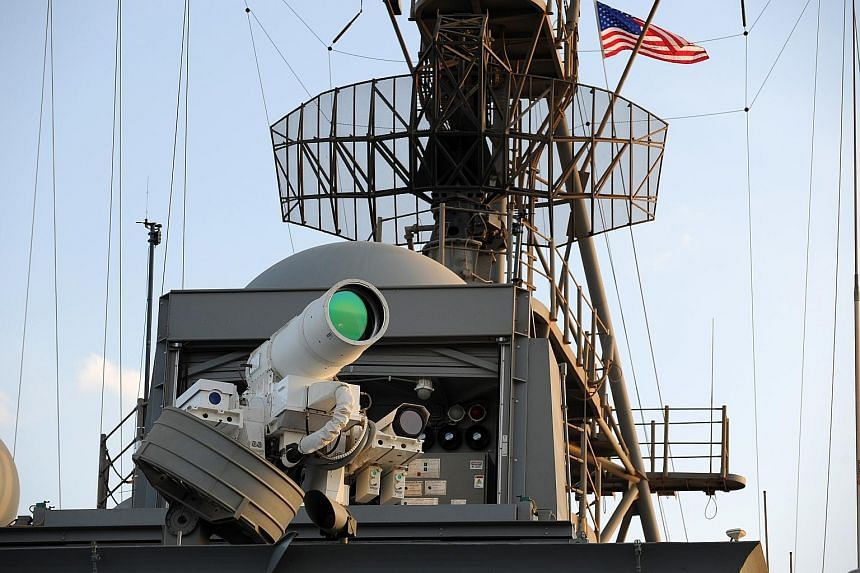 US navy warship USS Ponce demonstrating the use of the Office of Naval Research- sponsored Laser Weapon System in November 2014.