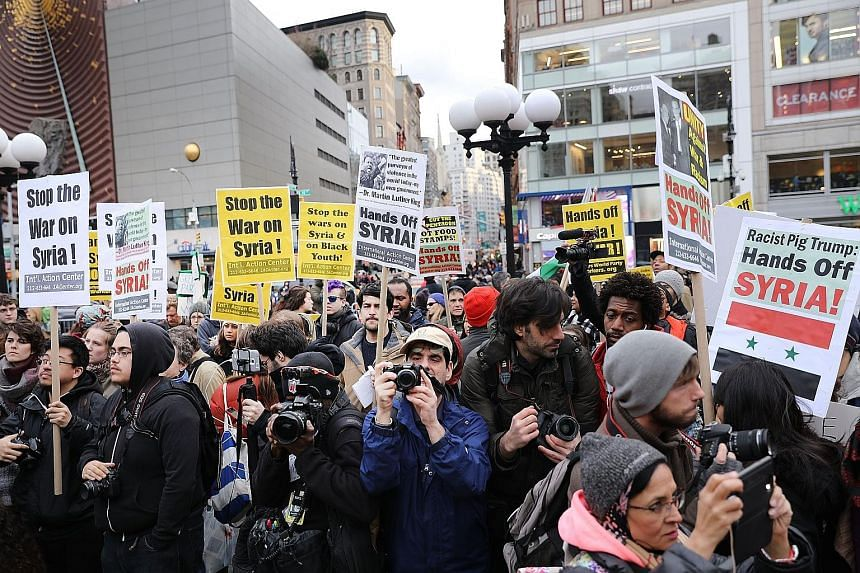 A protest in New York against the US missile attack on Syria last week ordered by President Donald Trump as punishment for the Assad regime's suspected chemical weapons attack that killed 86 people.