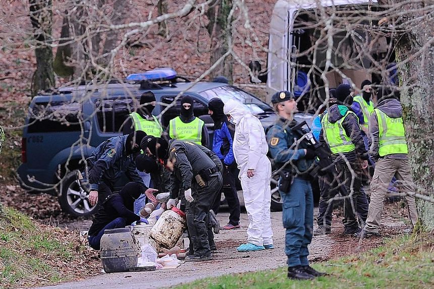 Spanish forces recovering explosives from a forest near the Spanish Basque city of Irun last month. The stash is believed to belong to the Basque separatist group ETA, which yesterday promised to completely disarm.