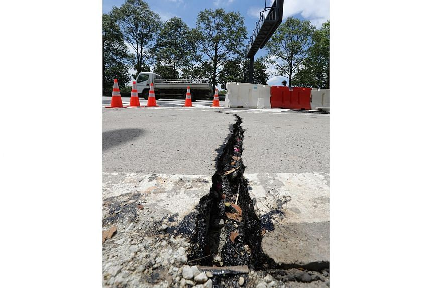 A crack is seen on the AYE after the ground heaved up following water pipe leaks in the Jurong area.