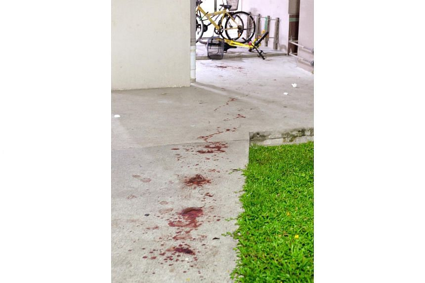 Blood stains are seen near the site of a slashing attack in Chai Chee, on April 8, 2017.