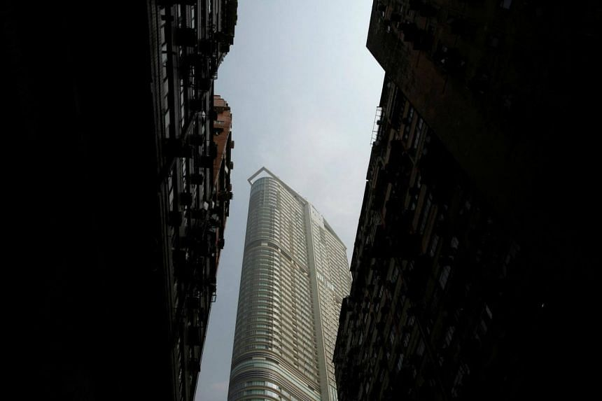 A newly built luxurious high rise residential building is seen in between old flats at Hong Kong's Tsim Sha Tsui district.