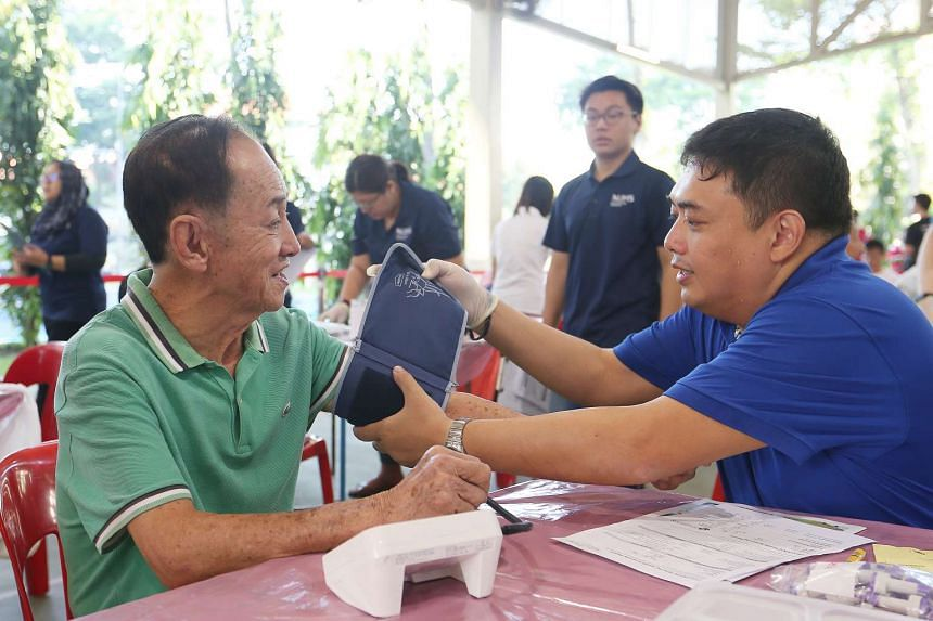 A resident of Jurong getting his blood pressure checked as part of Project Big Heart, on April 9, 2017.