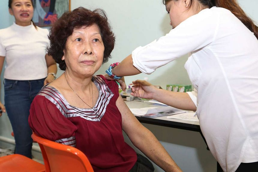 A resident of Jurong receiving a flu vaccination, on April 9, 2017.
