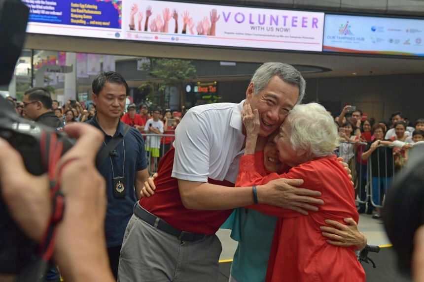 Mrs Therese Stewart (in red), 102, and her daughter, Ms Olivia Stewart, 74, hugging PM Lee Hsien Loong during the launch of the Eurasian Festival at the Tampines Hub, on April 9, 2017.