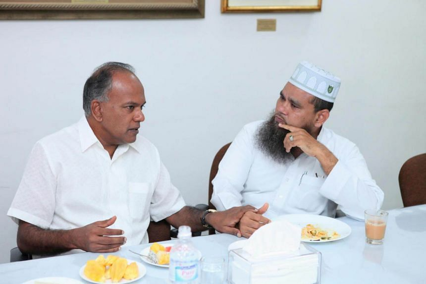 Law and Home Affairs Minister K. Shanmugam speaks with  Imam Nalla Mohamed Abdul Jameel during a breakfast session at the Ba'alwie Mosque on April 5, 2017.
