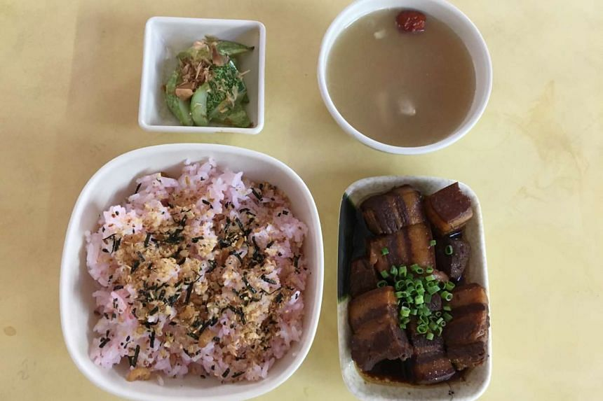 The braised pork belly umeboshi rice set comes with a side dish and free flow of soup.