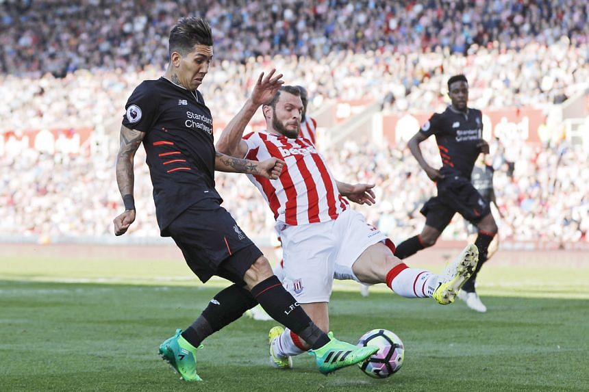 Liverpool's Roberto Firmino on the ball as Stoke's Erik Pieters challenges him. Firmino hit the winner after Philippe Coutinho equalised.