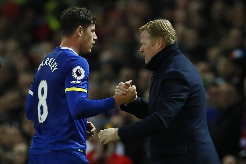 Everton manager Ronald Koeman (right) with midfielder Ross Barkley during a match against Manchester United on April 4.