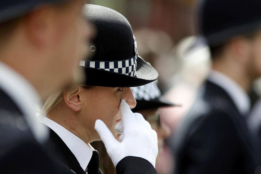 A police officer reacts outside Southwark Cathedral ahead of the funeral of PC Keith Palmer, who was killed in the recent Westminster attack, in central London, Britain on April 10, 2017.