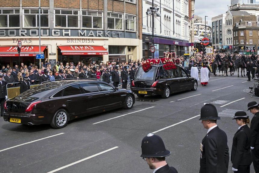The hearse carrying PC Keith Palmer is driven through Southwark for a full Police funeral at Southwark Cathedral, south east London, Britain,  on April 10, 2017.