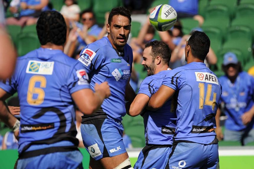 Western Force's players celebrate the team's first try during the Super Rugby match against South Africa's Kings in Perth on April 9.