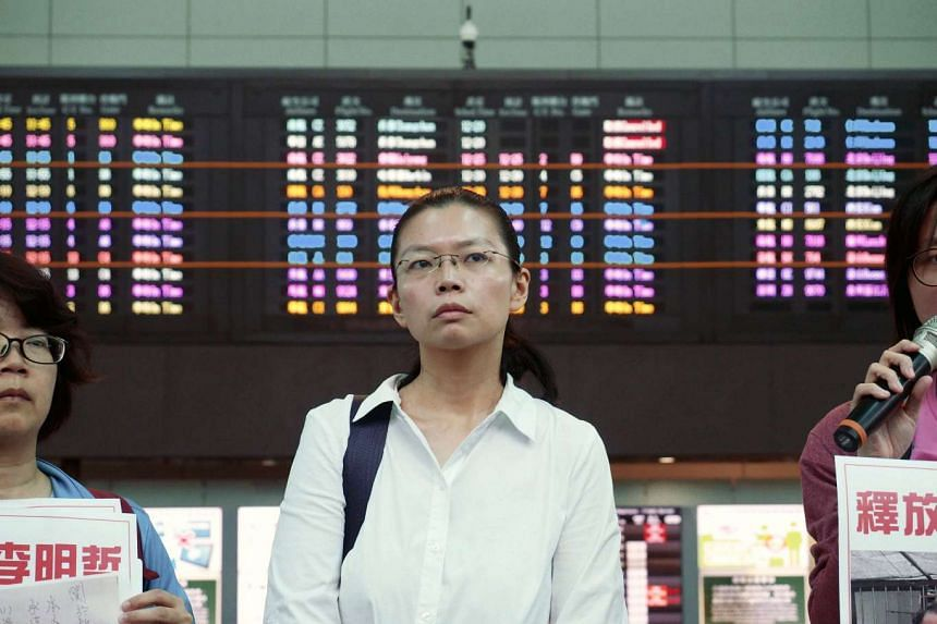 Activist Li Ming-che's wife, Li Ching-yu, had been scheduled to fly to Beijing but told reporters that her permit to enter China had been cancelled.