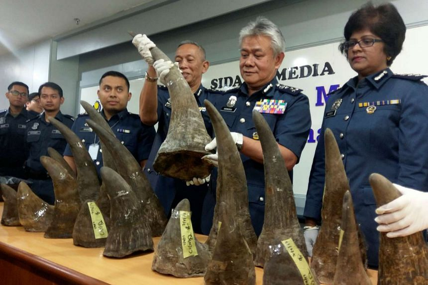 KLIA customs director Hamzah Sundang (second from right) with the rhino horns that were seized.
