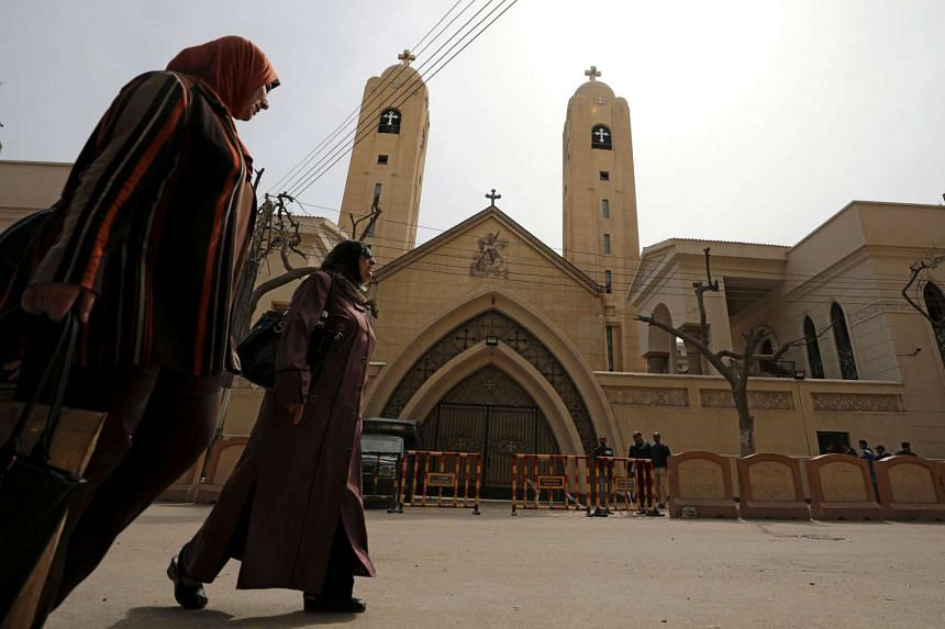 Women walk past the Coptic church that was bombed on April 9.