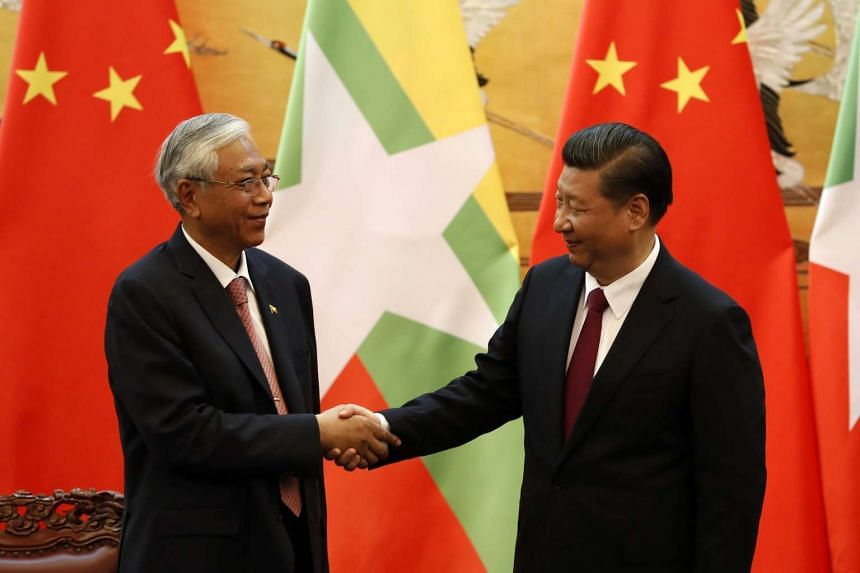 Chinese President Xi Jinping (right) with Myanmar President Htin Kyaw at a meeting in Beijing.